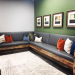 Large sectional couch against white and green walls
