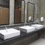 Three bathroom sinks in clubhouse washroom